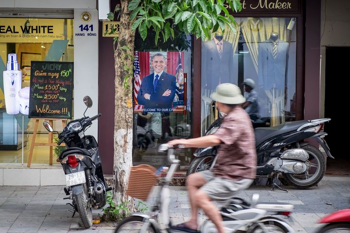 A poster of U.S. President Barack Obama in front of a tailor shop on May 23, 2016 in Hanoi, Vietnam.