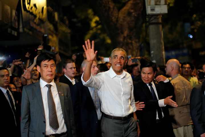 U.S. President Barack Obama waves as he leaves after having a dinner with Anthony Bourdain at a restaurant in Hanoi, Vietnam