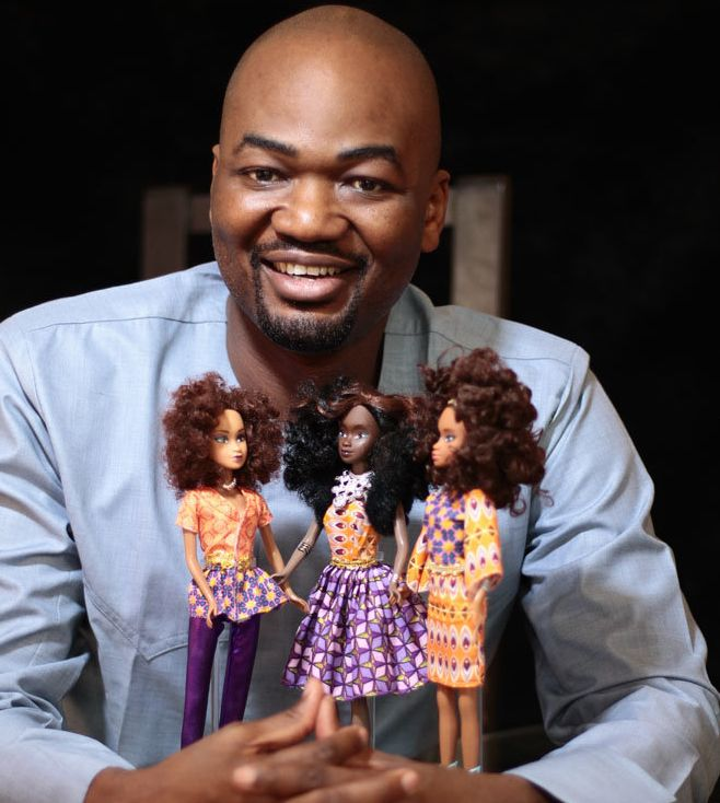 Taofick Okoya poses with the Queens of Africa dolls.