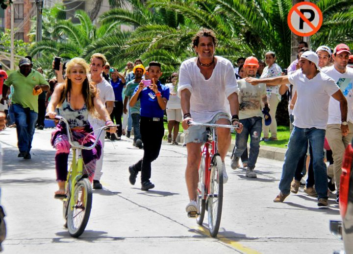 Dozens of fans showed up to watch the two Colombian singers ride their bicycles.
