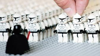 EMBARGOED. NOT FOR PUBLICATION BEFORE 00.01HRS MONDAY JUNE 30.   STANDALONE PHOTO  A LEGO UK employee helps assemble the Guinness World Record largest ever number of LEGO Star Wars Clone Troopers built and displayed in one location at LEGO UK Headquarters, Slough.