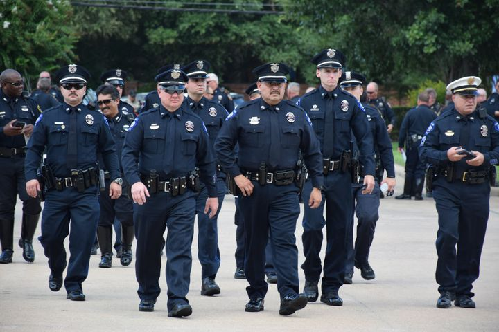 Policemen arrive at the funeral for Harris County Deputy Darren Goforth in Houston on Sept. 4, 2015.
