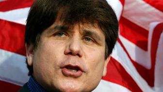 Former Illinois Governor Rod Blagojevich makes a statement to reporters outside his Chicago home one day before reporting to federal prison in Colorado to serve a 14-year sentence for corruption, March 14, 2012. REUTERS/Jeff Haynes (UNITED STATES - Tags: CRIME LAW POLITICS)