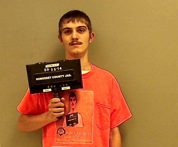Robert Burt, 19, wore his mugshot in his mugshot following a drunk driving arrest in 2014.