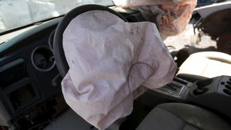 A deployed Takata manufactured airbag is seen on the driver's side of a 2007 Dodge Charger vehicle at a recycled auto parts lot in Detroit, Michigan May 20, 2015.  Japanese air bag manufacturer Takata Corp is doubling a recall of potentially deadly air bags to nearly 34 million vehicles, making it the largest automotive recall in American history, U.S. safety regulators said on Tuesday. REUTERS/Rebecca Cook