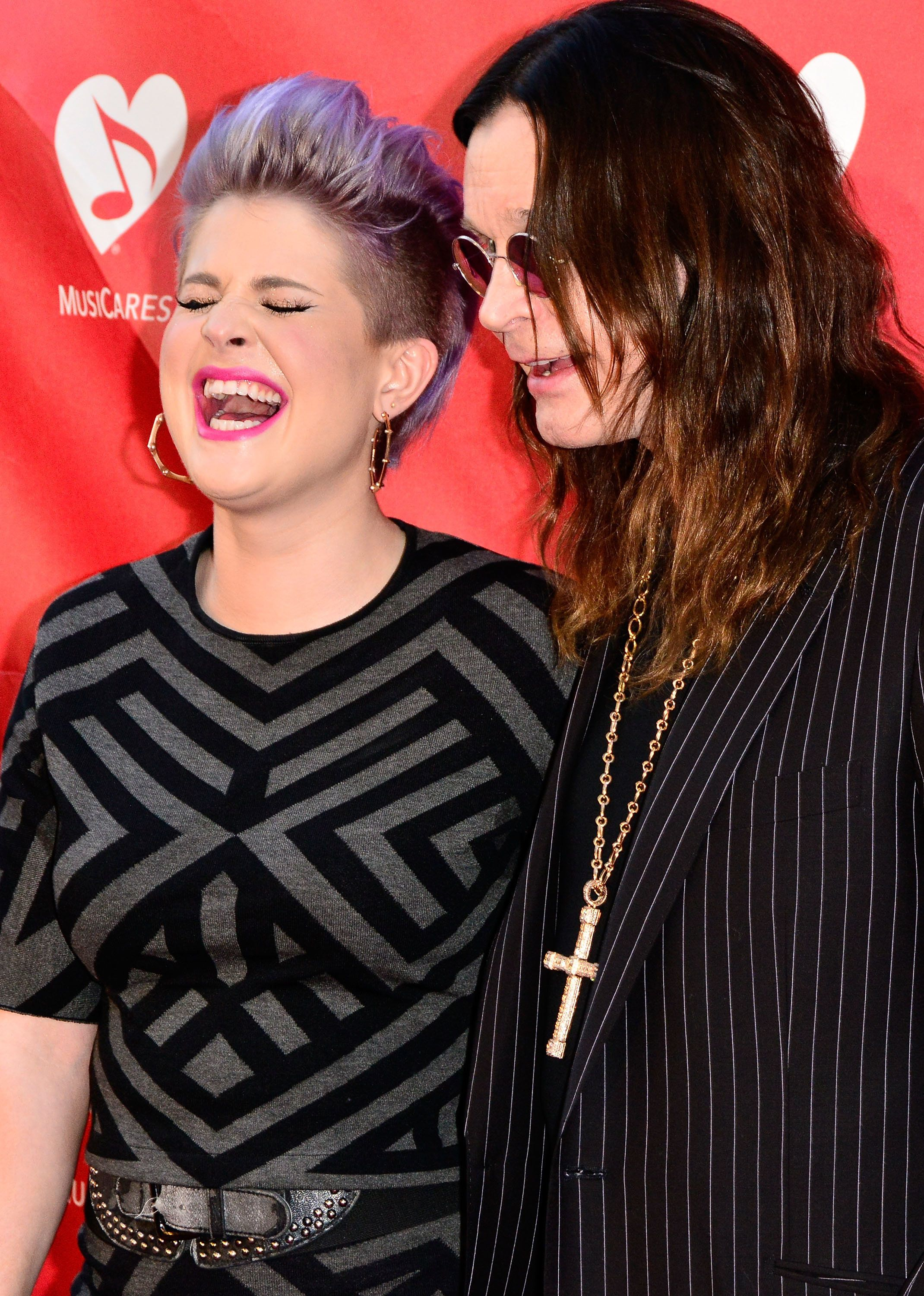 LOS ANGELES, CA - MAY 12:  Kelly Osbourne and Ozzy Osbourne arrive at the 2014 MusiCares MAP Fund Benefit Concert at Club Nokia on May 12, 2014 in Los Angeles, California.  (Photo by Jerod Harris/WireImage)