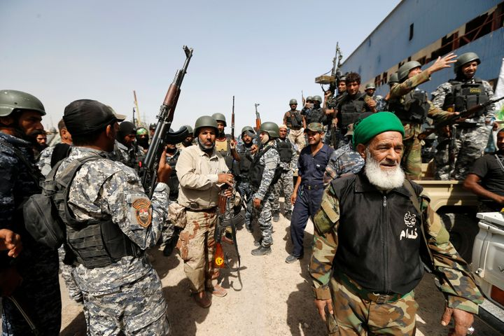 Iraqi forces entered a second day of an assault to retake Fallujah from the self-styled Islamic State.