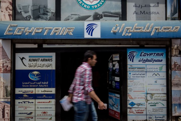 Pedestrians walk past a tour agency promoting flights by EgyptAir on May 23, 2016 in Cairo, Egypt.