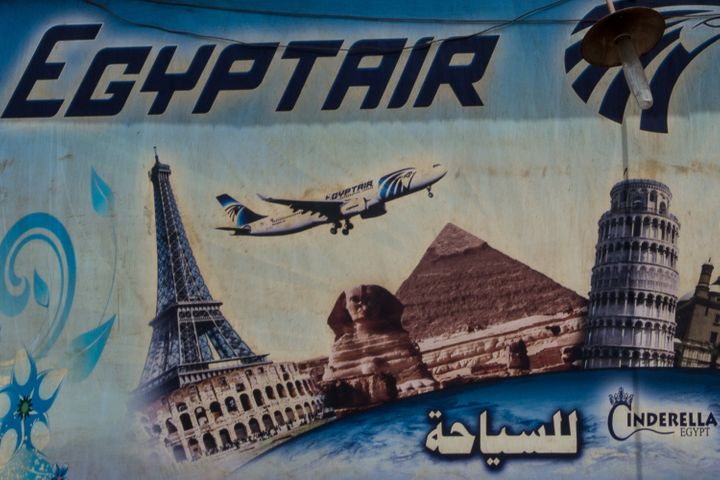 An advert promoting EgyptAir is seen on the outside of a travel agency on May 23, 2016 in Cairo, Egypt.