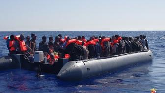 AT SEA, UNSPECIFIED - MAY 23: 138 Refugees, trying to pass Europe, are seen on a boat at the middle of the Mediterranean Sea before Italian security forces rescued them at the Mediterranean Sea in an unspecified location on May 23, 2016. (Photo by Italian Army / Marina Militare/Anadolu Agency/Getty Images)