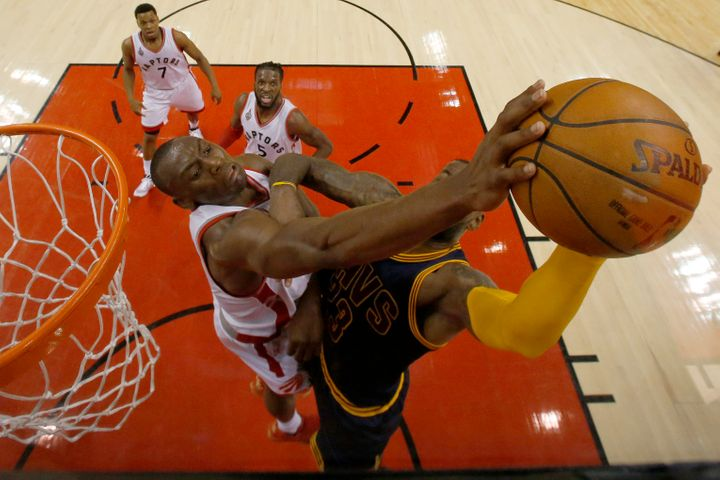 Toronto Raptors center Bismack Biyombo is called for a foul as he stops Cleveland Cavaliers forward LeBron James.