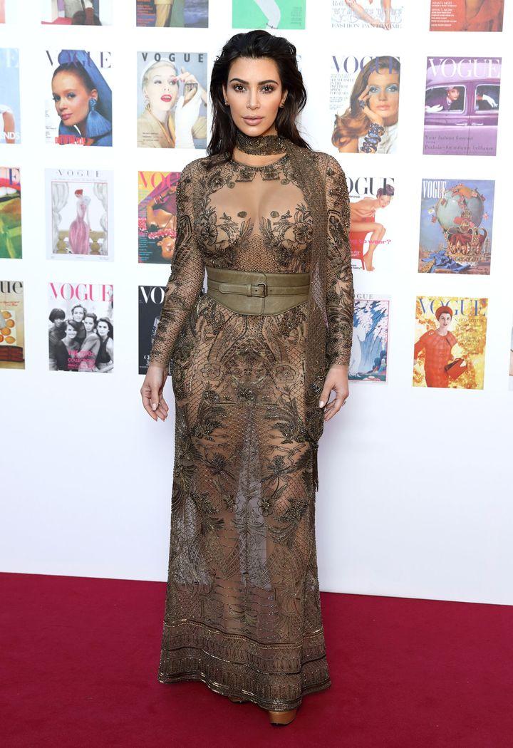Kim Kardashian Goes Sheer in Lace Dress for Vogue 100
