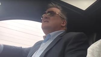"""An Australian dad was filmed going mad after a """"honk if you're horny"""" sign was placed on his car."""