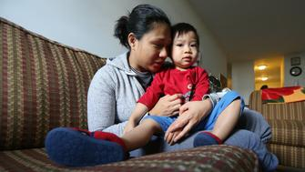 TORONTO, ON- NOVEMBER 22:  Etobicoke single mom Laurice Loo and her 2-year-old son Timothy (also goes by TJ). Timothy is among Canada's 1.34 million children living in poverty that Campaign 2000 hopes will be helped by the new Trudeau government's Canada Child Benefit and promises to fight poverty.        (Steve Russell/Toronto Star via Getty Images)