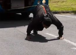 Watch This Strongman Pull A 9.5-Ton Truck Using Only His Hair