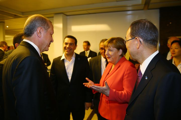 Turkish President Recep Tayyip Erdogan (left) talks with U.N. Secretary General Ban Ki-moon (right), German Chancellor Angela