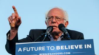 US Democratic presidential candidate Bernie Sanders speaks during a rally at Santa Monica High School Football Field in Santa Monica, California, on May 23, 2016. Democratic presidential frontrunner Hillary Clinton on May 23 rejected an invitation to take part in a final campaign debate against her rival Bernie Sanders, her campaign said. / AFP / Ringo Chiu        (Photo credit should read RINGO CHIU/AFP/Getty Images)