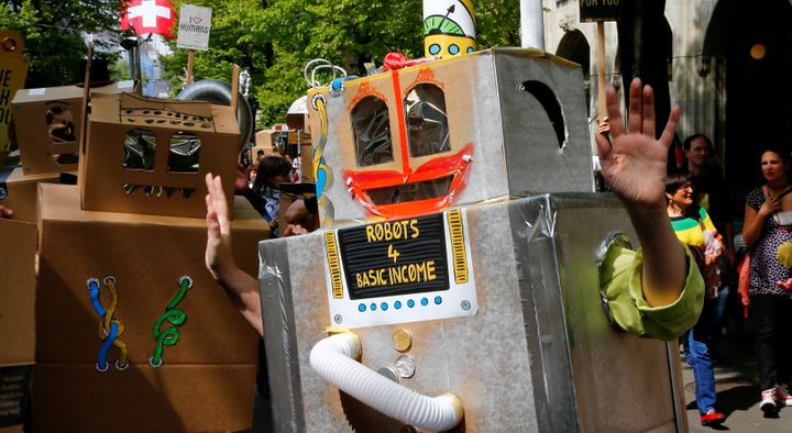 Protesters dressed as robots demand a basic income for everyone during a demonstration at the Bahnhofstrasse in Zurich, Switz