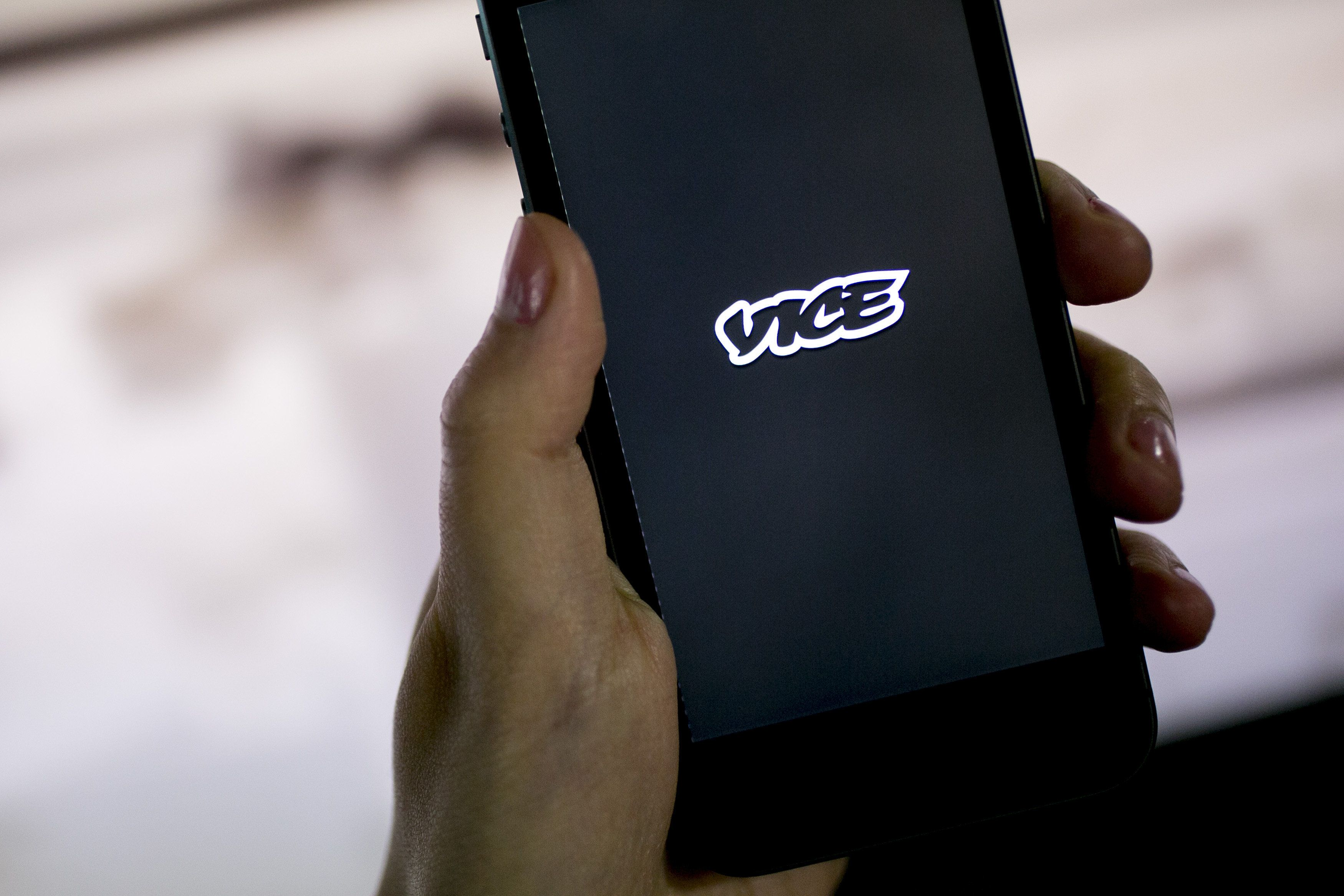 The Vice Media Inc. application (app) is displayed on an Apple Inc. iPhone 5s for an arranged photograph in Washington, D.C., U.S., on Monday, Aug. 11, 2014. Vice Media, backed by billionaire Rupert Murdoch, has said that it's poised to double revenue to $1 billion by 2016. Co-founder Shane Smith had said a March interview with Bloomberg Television that Vice Media may pursue an initial public offering. Photographer: Andrew Harrer/Bloomberg via Getty Images
