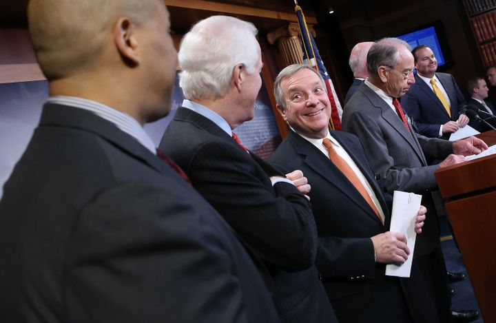 Senate Minority Whip Dick Durbin (third from left) is irritated Senate Republicans have not brought up criminal justice refor
