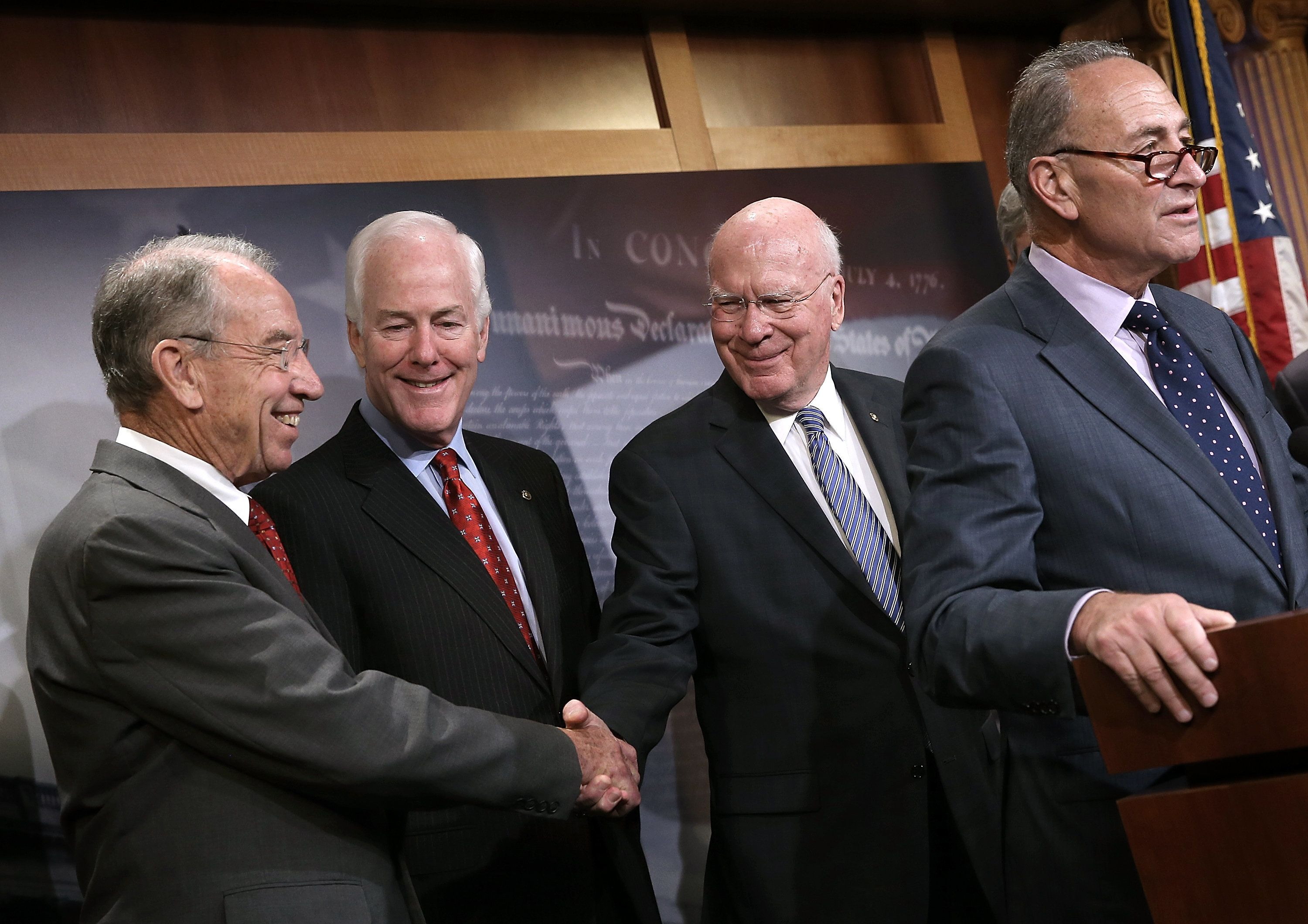 WASHINGTON, DC - OCTOBER 01:  Senate Judiciary Committee Chairman Sen. Chuck Grassley (L) (R-IA) shakes hands with ranking member Sen. Patrick Leahy (2nd R) (D-VT) during a press conference at the U.S. Capitol announcing a bipartisan effort to reform the criminal justice system October 1, 2015 in Washington, DC. A bipartisan group of senators led by Grassley and Assistant Democratic Leader Dick Durbin (D-IL) is introducing legislation aimed at restructuring prison sentences for certain drug offenders, targeting violent criminals, and granting judges greater discretion at sentencing in lower-level drug crimes. Also pictured are Sen. John Cornyn (2nd L) (R-TX) and Sen. Chuck Schumer (R) (D-NY).  (Photo by Win McNamee/Getty Images)