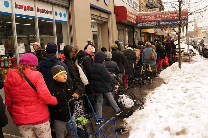 People wait in line at afood pantry in Brooklynon February 18, 2014.Currently the food pantry sees up to 4,