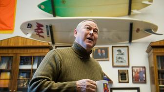 UNITED STATES - JANUARY 13:  Rep. Dana Rohrabacher, R-Calif., gives a tour of his Rayburn Building office to Roll Call.  Behind him are surfboards he used on his honeymoon.  (Photo By Tom Williams/Roll Call)