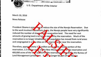 Forged document purporting to be an announcement that the Department of Interior is seeking to claim land from the Navajo Nation.