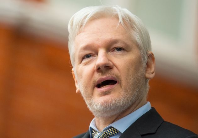 Assange used his embassy pet to hit back at the