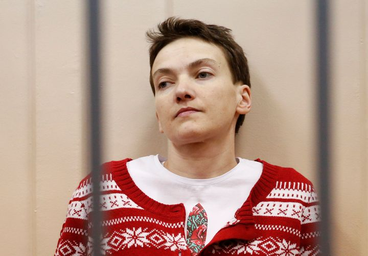 Ukrainian military pilot Nadezhda Savchenko looks out from a defendants' cage as she attends a court hearing in Moscow March