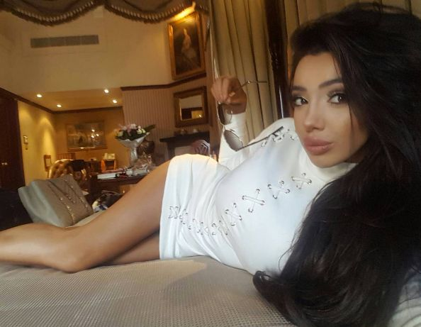 Chloe Khan lounging casually in a