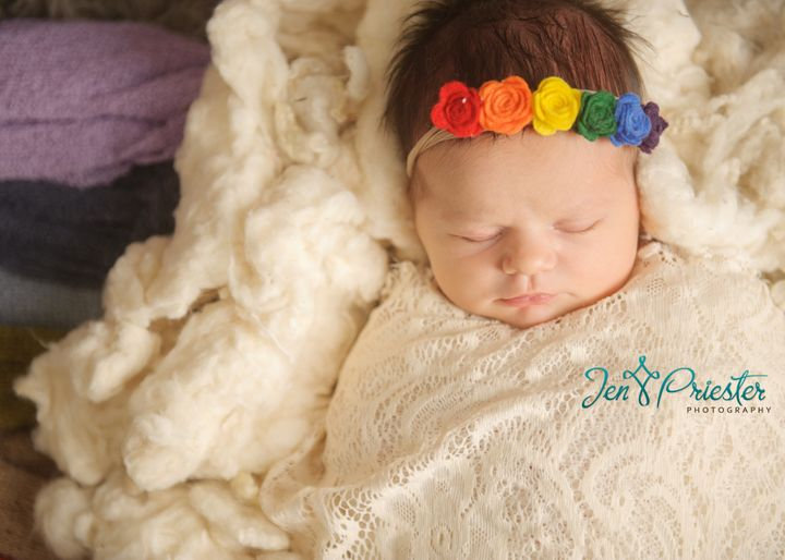 Cathy Matthews enlisted photographer Jen Priester to take these gorgeous rainbow baby pictures.