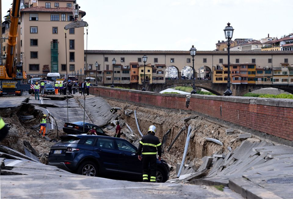 A road in central Florence collapsed on Wednesday, causing some 20 cars to fall into a ditch and cutting...