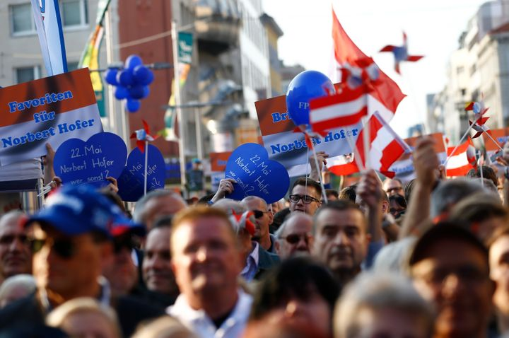 Supporters hold placards and wave flags for Austrian far-right Freedom Party presidential candidate Norbert Hofer. Hofer narrowly lost the Austrian election on Monday.