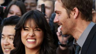 FRANCE - MARCH 18:  Michelle Rodriguez, actress and Paul Walker, actor in Lomme, France on March 18th, 2009.  (Photo by Franck CRUSIAUX/Gamma-Rapho via Getty Images)