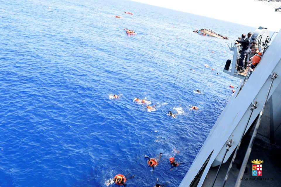 Desperate Migrants Pictured Clinging To Sinking Boat In The Mediterranean, As Death Toll Reaches
