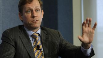 """Peter Thiel, entrepreneur and co-founder of PayPal, speaks during a news conference on """"nonprofit, nonpartisan organization dedicated to economic research and innovative public policies for the 21st century"""" at the National Press Club  in Washington October 3, 2011. REUTERS/Yuri Gripas (UNITED STATES - Tags: BUSINESS)"""