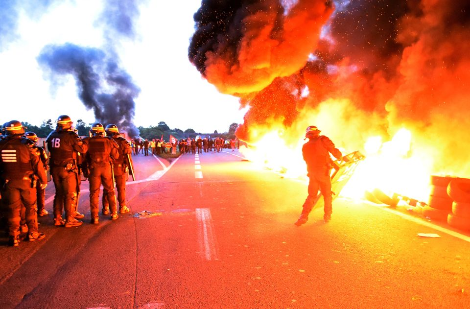 Fiery scenes at Douchy-les-Mines, France, as police break up a labor protest.