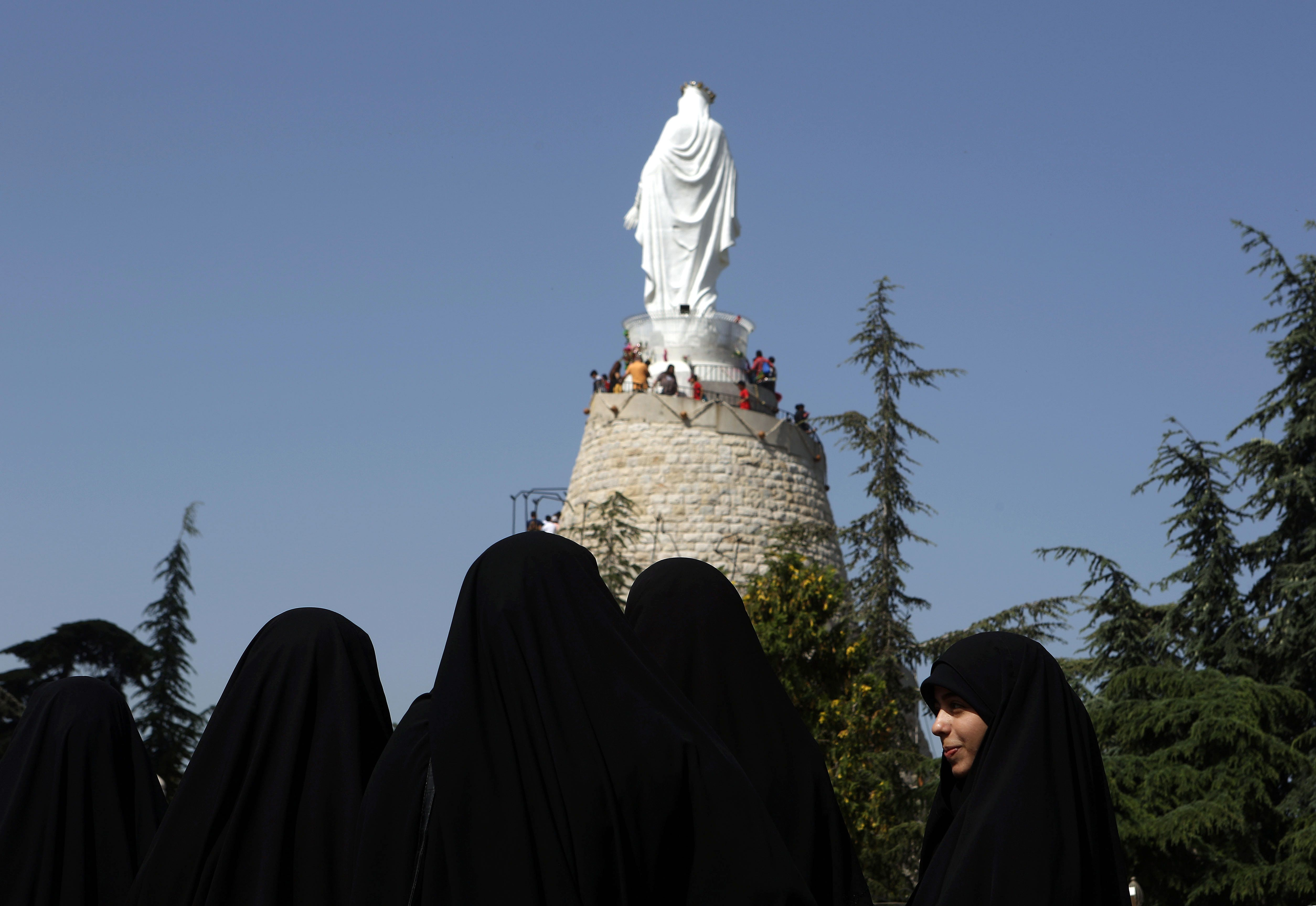 Lebanese Muslim Shiite women members of of Hezbollah's al-Mehdi movement visit a church at the shrine of Our Lady of Lebanon in the town of Harissa north east of the Lebanese capital Beirut, marking the start of the Holy Month of Virgin Mary, on May 1, 2016. Virgin Mary is considered one of the most righteous and greatest women in Islam and is venerated by both Islam and Christianity. / AFP / PATRICK BAZ        (Photo credit should read PATRICK BAZ/AFP/Getty Images)