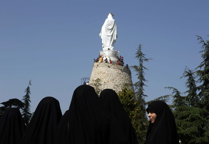 Lebanese Muslim Shiite women visit The Shrine of Our Lady of Lebanon in Harissa, Lebanon on May 1, 2016.