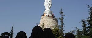 HORIZONTAL MIDDLE EAST CHRISTIAN RELIGION EFFIGY STATUE VISIT SHIITE MUSLIM WOMAN HEZBOLLAH