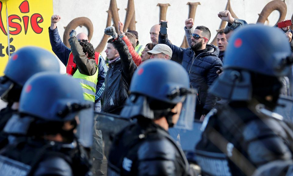 French gendarmes observe striking workers near the oil refinery at Fos-sur-Mer, France, on May 24,