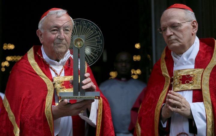 Archbishop of Westminster Cardinal Vincent Nicolls (L) receives the Hungarian relic of St Thomas a Becket from Archbishop of