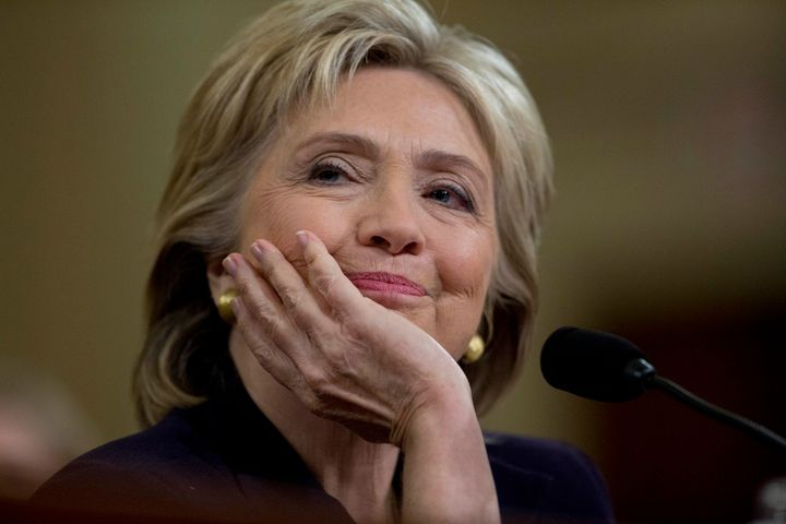 Hillary Clinton, former U.S. secretary of state and 2016 Democratic presidential candidate, smiles while testifying during a