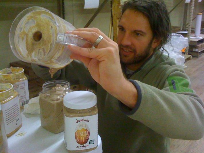 In this 2010 photo, Justin Gold scoops out a fresh batch of vanilla-flavored almond butter.