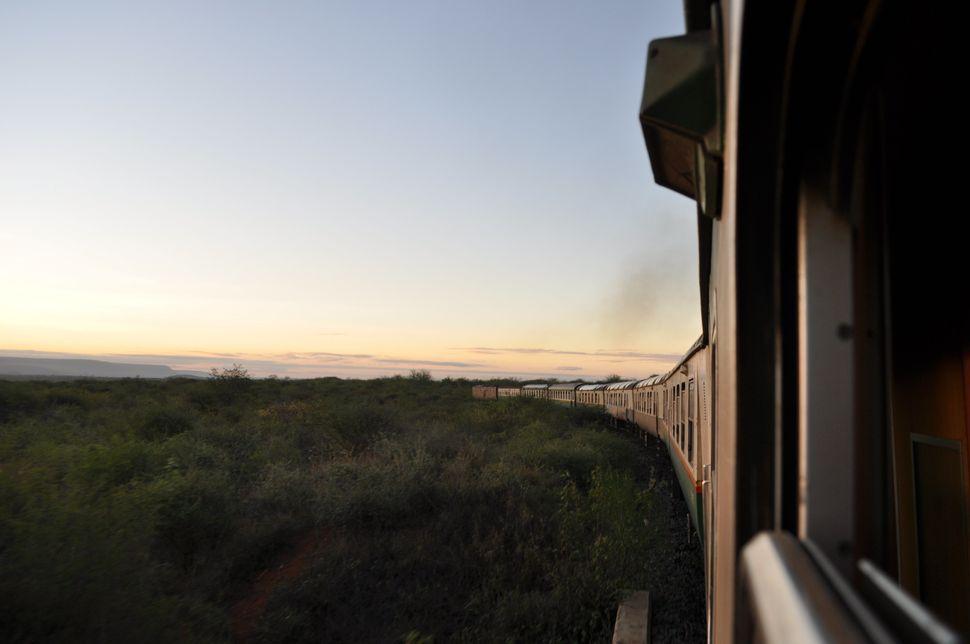 Atrain goes through Tsavo East National Park in Kenya.