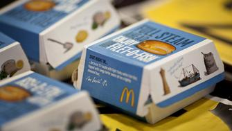 Filet-O-Fish sandwiches are displayed for a photograph on a tray at a McDonald's Corp. restaurant in Little Falls, New Jersey, U.S., on Wednesday, Feb. 15, 2012. McDonald's Corp., the world's largest restaurant chain, said sales at stores open at least 13 months rose 6.7 percent globally last month as beverages and Chicken McBites helped the U.S. business. Photographer: Emile Wamsteker/Bloomberg via Getty Images