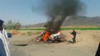 A car is seen on fire at the site of a drone strike believed to have killed Afghan Taliban leader Mullah Akhtar in southwest Pakistan in this still image taken from video, May 21, 2016. REUTERS/via REUTERS TV     TPX IMAGES OF THE DAY