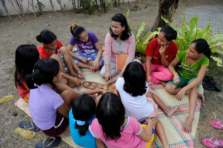 Cecilia (center in pink) in a healing session with trafficking survivors.