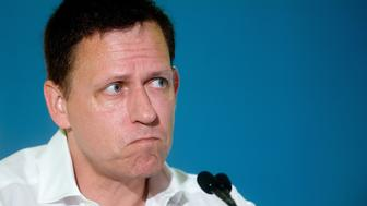 Peter Thiel, head of Clarium Capital Management LLC and founding investor in PayPal Inc. and Facebook Inc., listens during the LendIt USA 2016 conference in San Francisco, California, U.S., on Tuesday, April 12, 2016. Thiel discussed his outlook for the tech industry. Photographer: Noah Berger/Bloomberg via Getty Images